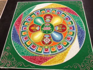 Tibetan Buddhist Monks from the Gaden Jangtse Monastery in South India create a mandala.
