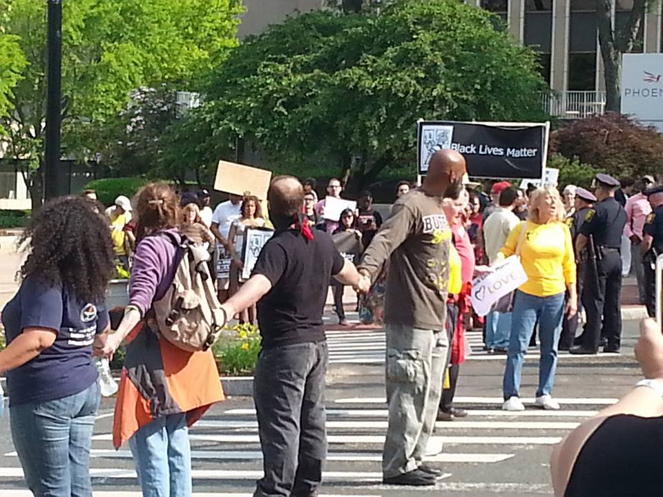 UUS:E member, Sofie Buyniski, on the line at Moral Monday CT